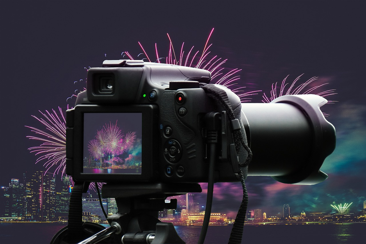 A camera placed in front of a landscape filled with fireworks